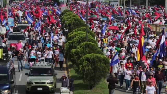 supporters of nicaraguan president daniel ortega demonstrate in a march called victorious september heroes of love always in managua - managua stock videos & royalty-free footage