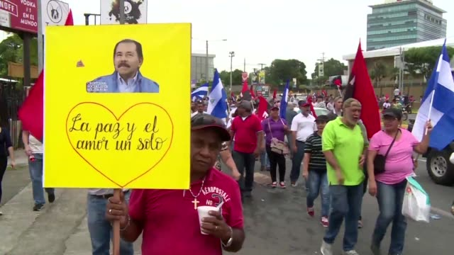 supporters of nicaragua's embattled president daniel ortega march in managua in favour of their leader who is facing a wave of anti government... - managua stock videos & royalty-free footage