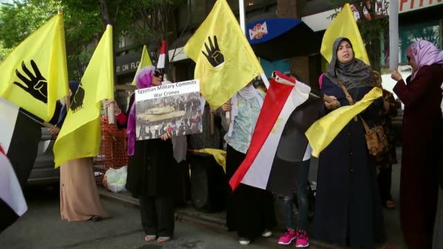 supporters of ousted egyptian president mohamed morsi hold banners during a rally in front of the egypt's embassy in new york united states on july... - president of egypt stock videos & royalty-free footage