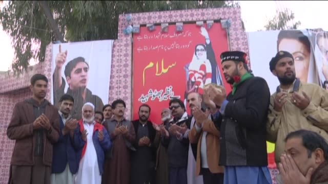supporters of pakistan people's party take part in a ceremony to commemorate the former pakistani prime minister benazir bhutto on the 8th... - pakistan stock videos & royalty-free footage