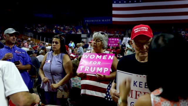 supporters of president donald trump attend a rally for him on august 21, 2018 in charleston, west virginia. paul manafort, a former campaign manager... - hat stock videos & royalty-free footage