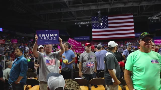 supporters of president donald trump attend a rally for him on august 21 2018 in charleston west virginia paul manafort a former campaign manager for... - プラカード点の映像素材/bロール