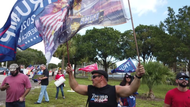 supporters of president donald trump demonstrate together outside where democratic presidential nominee joe biden is holding a campaign rally at the... - political rally stock videos & royalty-free footage