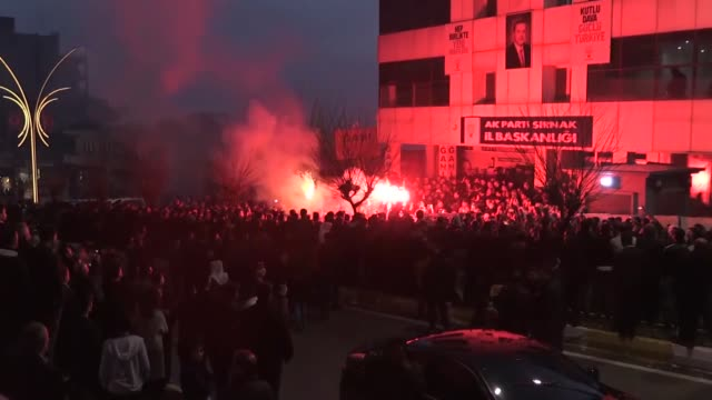 supporters of ruling justice and development party's candidate mehmet yarka celebrate following the announcement of the unofficial results for... - silopi stock videos and b-roll footage