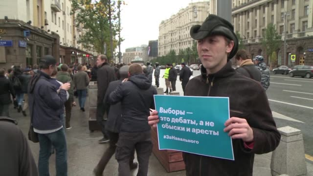 Supporters of Russia's jailed opposition leader Alexei Navalny express their discontent at his imprisonment on the birthday of Russian president...