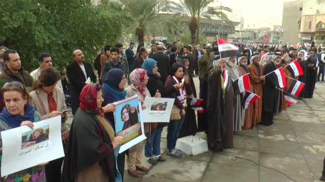 supporters of shiite cleric muqtada alsadr hold banners and chant slogans during a demonstration against corruption and demand of reforms in the... - muqtada al sadr stock videos & royalty-free footage