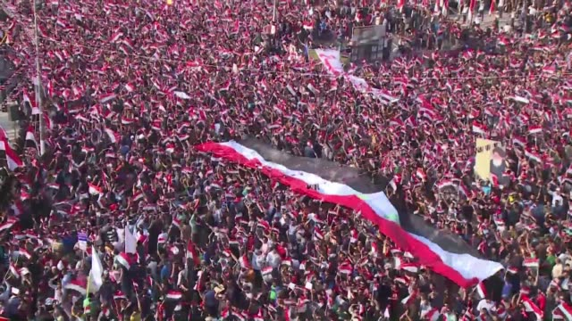 supporters of shiite radical leader moqtada sadr demonstrated in central baghdad for a third straight week on friday to press the government to... - muqtada al sadr stock videos & royalty-free footage