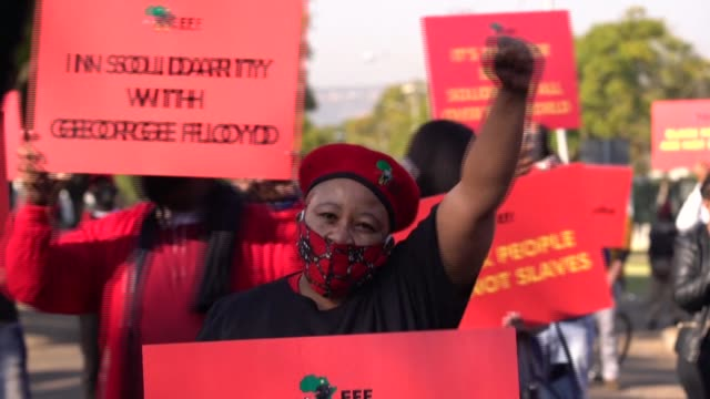 supporters of south africa's radical leftwing party the economic freedom fighters protest against racism and police brutality in solidarity with the... - racism stock videos & royalty-free footage