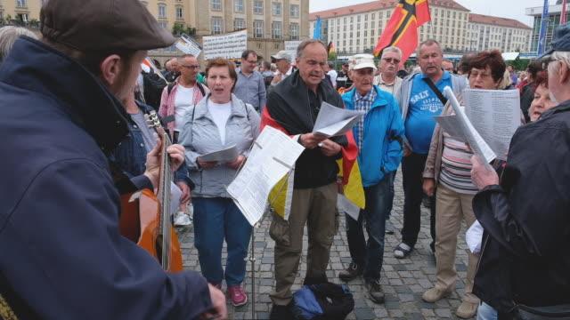 DEU: Pegida Gathering Coincides With Merkel Visit