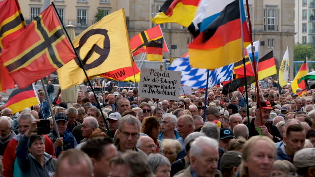 supporters of the anti-muslim pegida movement march in their 187th weekly, monday night gathering not far from the venue where german chancellor... - dresden germany stock videos & royalty-free footage