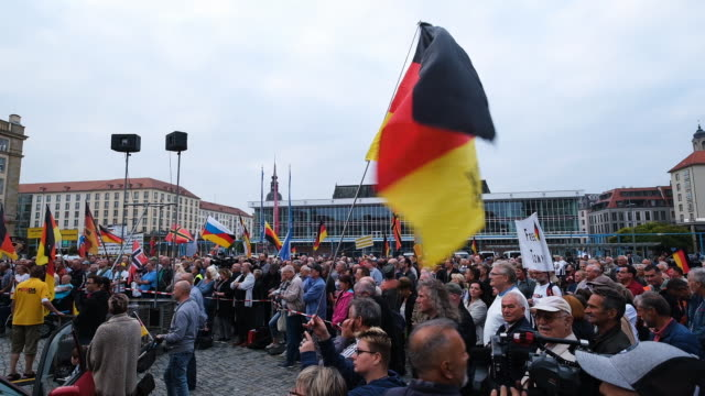 supporters of the anti-muslim pegida movement march in their 187th weekly, monday night gathering not far from the venue where german chancellor... - saxony stock videos & royalty-free footage