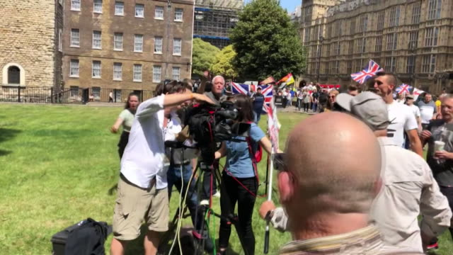 supporters of the far right activist tommy robinson, surround and threaten journalists filming on college green by houses of parliament, after he was... - cinematographer stock videos & royalty-free footage