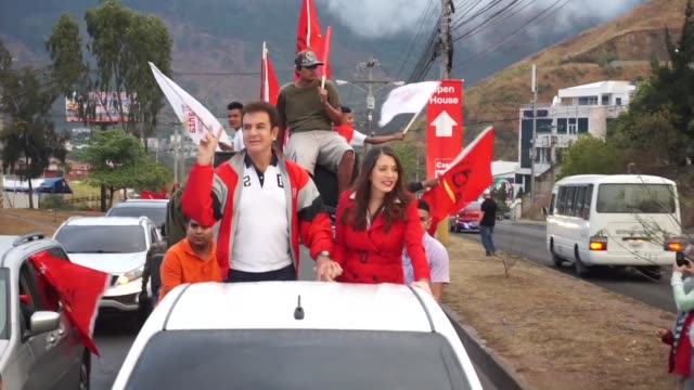 Supporters of the former Honduran presidential candidate and opposition leader Salvador Nasralla take part in the caravan of the insurrection on...