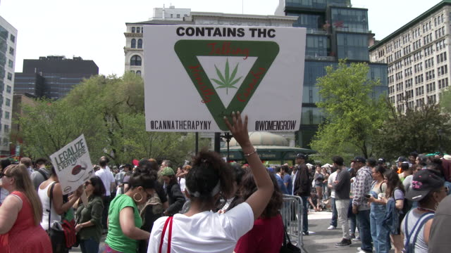 Supporters of the legalization of Marijuana hold up signs as they listen to speakers at the Cannabis Day Rally in Union Square Park New York