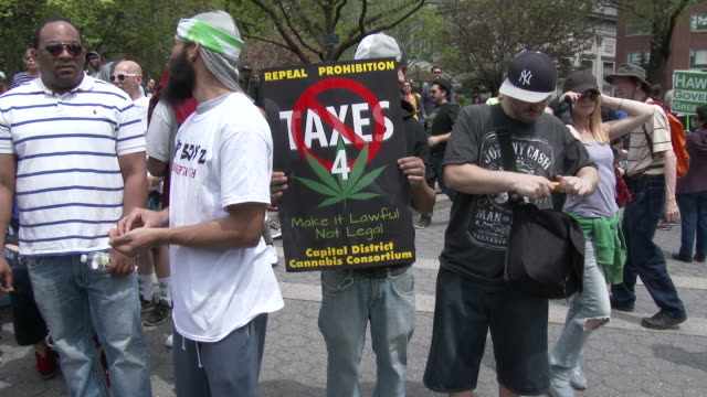 Supporters of the legalization of Marijuana hold up signs in Union Square Park at the annual Cannabis Day Rally in downtown Manhattan
