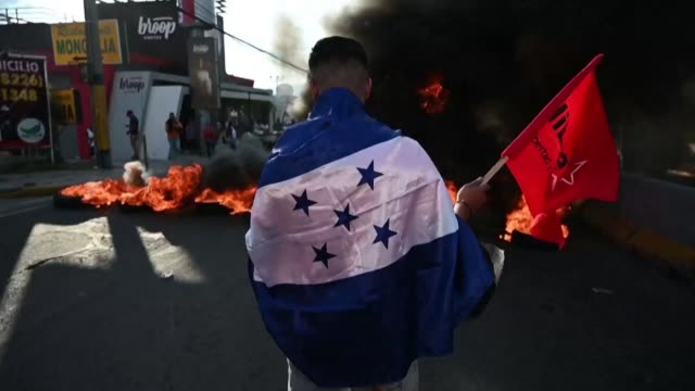 supporters of the libertad y refundacion party protest around the presidential palace to demand the resignation of honduran president juan orlando... - drug trafficking stock videos & royalty-free footage