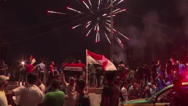 supporters of the marching toward reform alliance of shiite cleric moqtada sadr and communists celebrate in baghdad's tahrir square late on sunday... - shi'ite islam stock videos & royalty-free footage