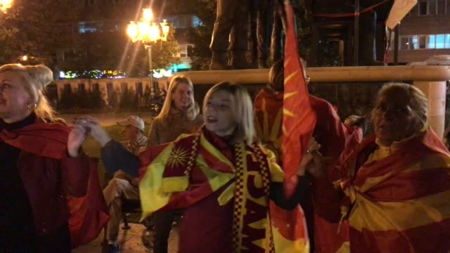 supporters of the movement to boycott the referendum vote celebrate in the street after election officials announced low voter turn out figures on... - macedonia country stock videos and b-roll footage