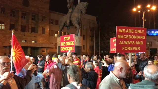 vídeos de stock, filmes e b-roll de supporters of the movement to boycott the referendum vote celebrate in the street after election officials announced low voter turn out figures on... - república da macedônia