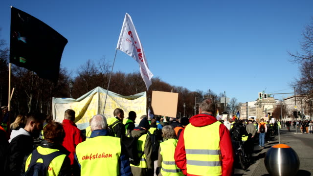 supporters of the new leftwing stand up movement gather at a demonstration on the way to the brandenburg gate on the right the american embassy can... - social movement stock videos and b-roll footage
