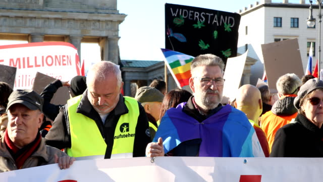 supporters of the new leftwing stand up movement gather at the end of a demonstration which started at potsdamer platz and ended here at the... - social movement stock videos & royalty-free footage