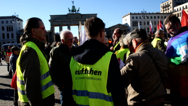 supporters of the new leftwing stand up movement gather at the end of a demonstration which started at potsdamer platz and ended here at the... - social movement stock videos and b-roll footage