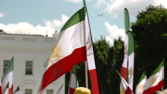 supporters of the organization of iranian american communities hold rally outside the white house many wear yellow hats and clothing calling for a... - teheran video stock e b–roll
