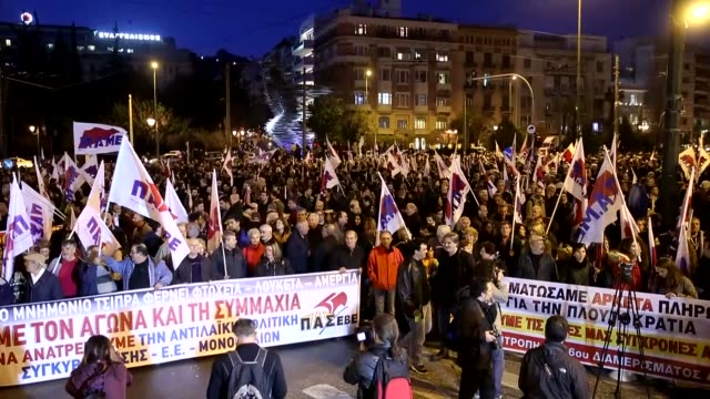Supporters of the PAME labour union take part in an antiausterity rally outside of the Hilton hotel where Greek officials hold meetings with the...