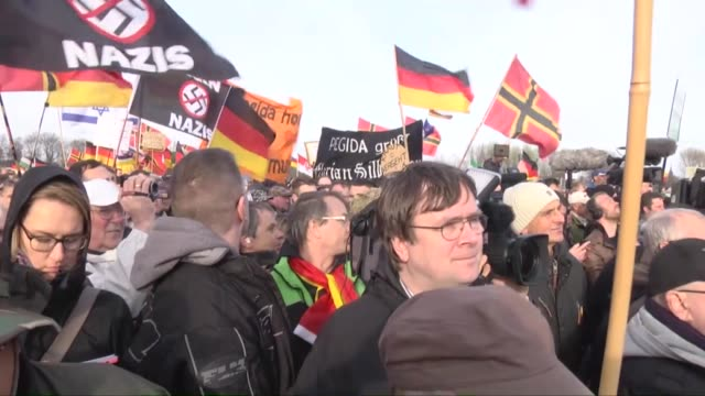 Supporters of the Pegida movement gather at another of their weekly protests on April 13 2015 in Dresden Germany Rightwing Dutch politician Geert...