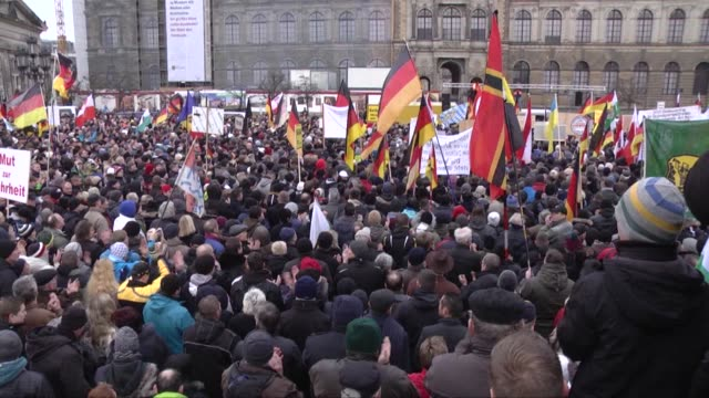 supporters of the pegida movement gather for another of their weekly protests in dresden, germany on sunday, january 25, 2015. the group usually... - dresden germany stock videos & royalty-free footage