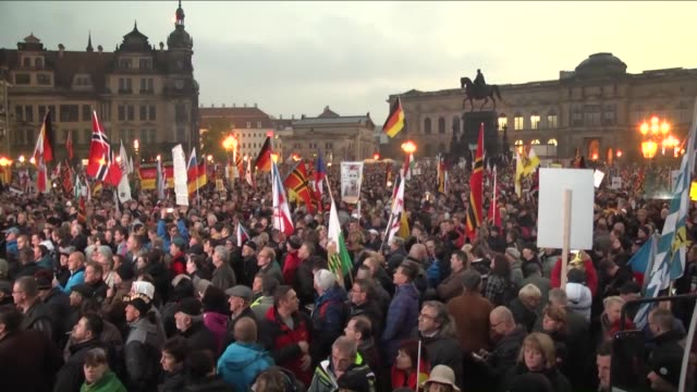 supporters of the pegida movement gather on the first anniversary of the anti-islam group march on october 19, 2015 in dresden, germany. - dresden germany stock videos & royalty-free footage