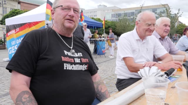 supporters of the rightwing alternative for germany attend an election campaign in the state of brandenburg and are wearing a tshirt with the... - engraved image stock videos and b-roll footage