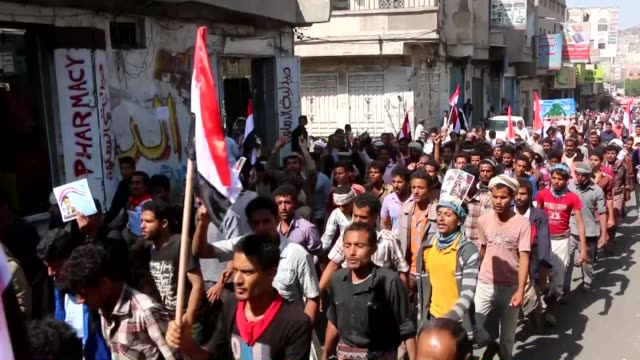supporters of the shiite huthi movement wave their national flag as they shout slogans during a rally commemorating the fifth anniversary of the 2011... - yemen stock videos & royalty-free footage