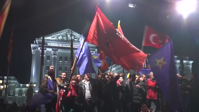 supporters of the social democratic union of macedonia party celebrate after preliminary results in the parliamentary elections in skopje macedonia... - skopje stock videos and b-roll footage