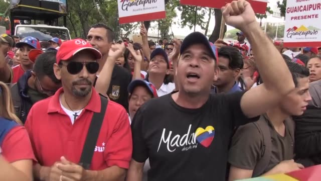 supporters of the venezuelan government rally in caracas to commemorate the triumph of late president hugo chavez in the 2012 presidential elections... - maduro stock videos & royalty-free footage