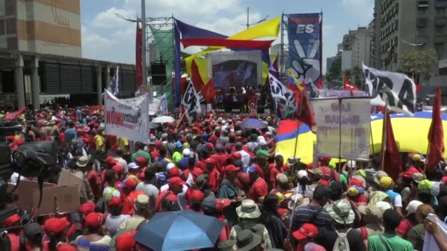 Supporters of the Venezuelan President Nicolas Maduro rally in Caracas to commemorate the one year anniversary of Maduro's re election for a second...