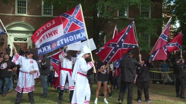 vídeos de stock, filmes e b-roll de supporters of the white supremacist ku klux klan marched in charlottesville virginia on saturday to protest the planned removal of a statue of... - ku klux klan