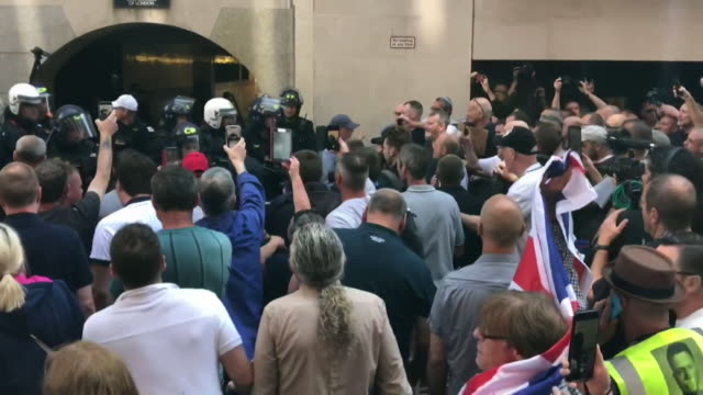 supporters of tommy robinson the far right activist attacking riot police outside the old bailey after he was sentenced to prison for contempt of... - prison riot stock videos & royalty-free footage