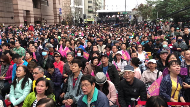 supporters of tsai ing-wen of the democratic progressive party wave flags and banners during a rally as the results as result of the presidential... - taipei stock videos & royalty-free footage