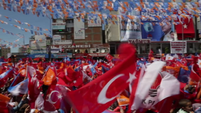 Supporters of Turkish President Recep Erdogan waving Turkish flags at a rally in the city of Van which has a large Kurdish population
