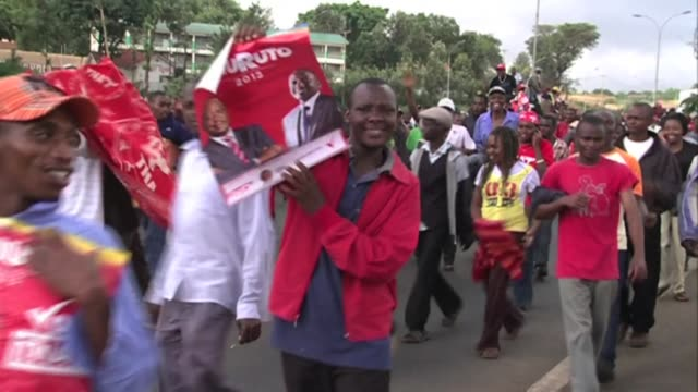 supporters of uhuru kenyatta celebrate his victory in kenyas presidential election as they walk on the thika road in nairobi as they walk to... - hometown stock videos and b-roll footage