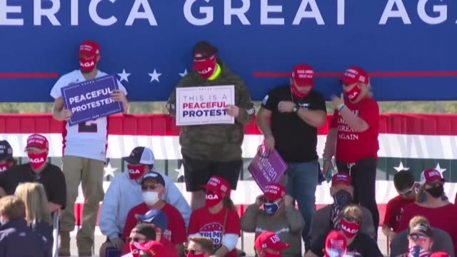 supporters of us president donald trump gather in greenville north carolina ahead of his campaign rally in the swing state on the day the second... - carolina del nord stato usa video stock e b–roll