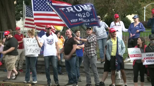 supporters of us president donald trump gather outside georgia's state capitol building in atlanta as joe biden is elected president - georgia us state stock videos & royalty-free footage