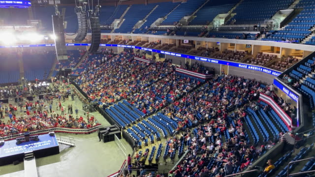supporters of u.s. president donald trump gather to attend his campaign rally later at the bok center, june 20, 2020 in tulsa, oklahoma. trump is... - political rally stock videos & royalty-free footage