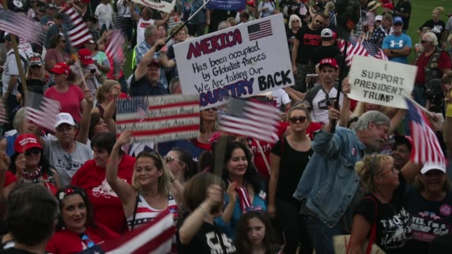 "vídeos de stock e filmes b-roll de supporters of us president donald trump participate in a ""mother of all rallies"" hundreds of supporters of us president donald trump from around the... - comício político"