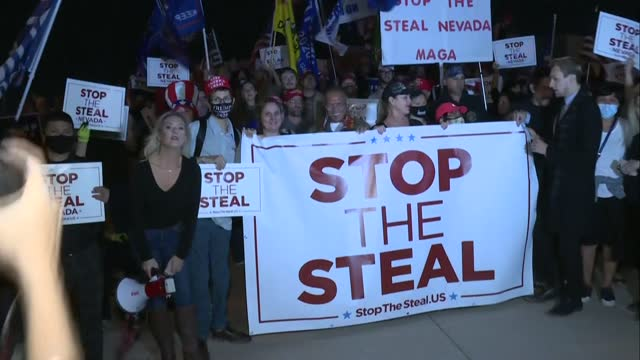 supporters of us president donald trump protest outside the clark county vote counting facility in las vegas, nevada - clark county nevada stock videos & royalty-free footage