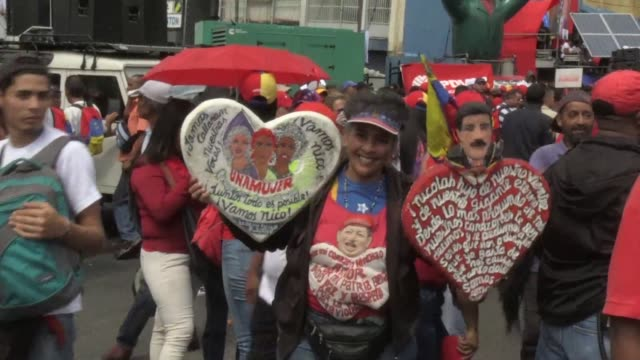supporters of venezuelan president nicolas maduro take the streets of caracas to show their support for their leader as he is sworn in for a second... - maduro stock videos & royalty-free footage