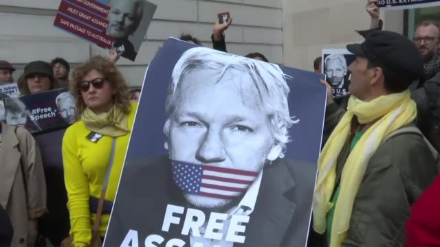 supporters of wikileaks founder julian assange gather in front of the london court where he faces an initial hearing over an extradition request from... - court hearing stock videos and b-roll footage