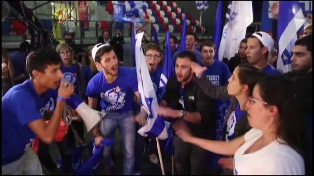 supporters of zionist union party celebrate after preliminary election results at the party's election campaign headquarters on march 18 2015 in tel... - qualification round stock videos & royalty-free footage