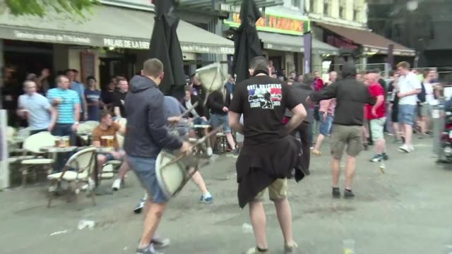 vídeos de stock, filmes e b-roll de supporters outside a bar in lille clashed ahead of wales match against england on wednesday amid heightened tension and tight security - euro 2016